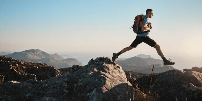 Rock hopping hiker