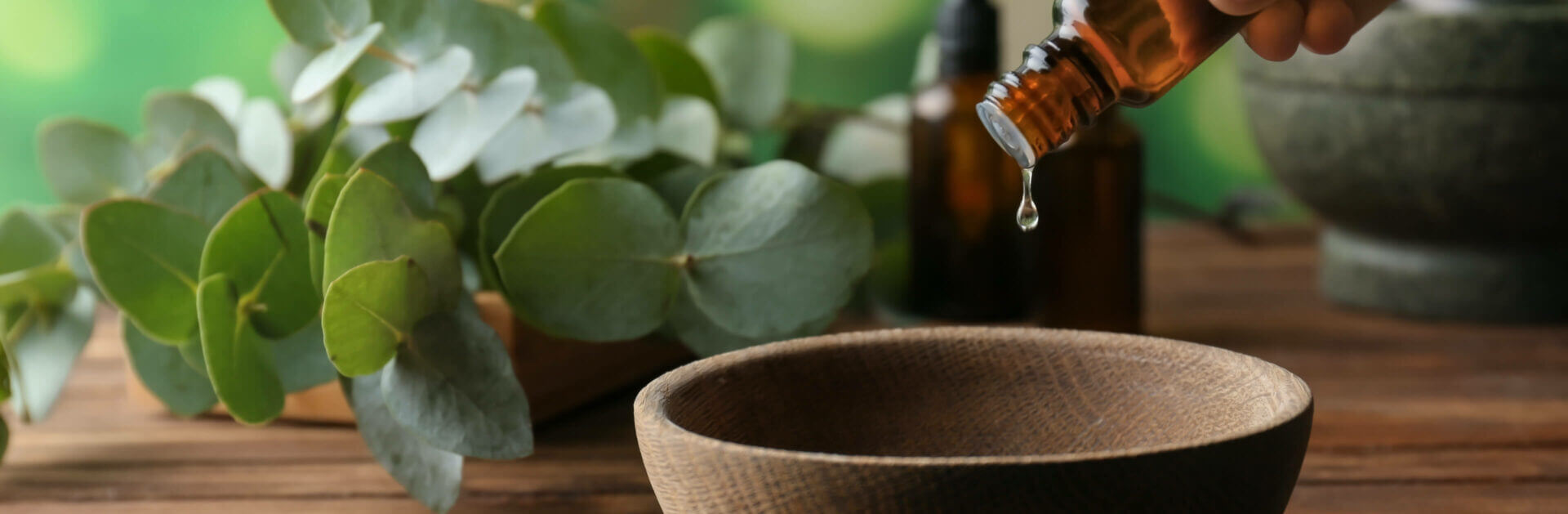 Essential oil dripping into a bowl